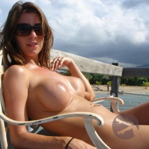 Solo girl on resort grounds enjoying the sun